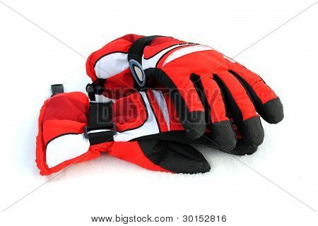 black and red winter gloves on the snow soft shadows