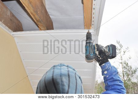 Roofer Contractor Installing On House Roof New  Soffit And Fascia. Roofing Construction. Soffit, Fas