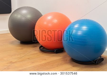 Fitness Balls On Wooden Floor In The Sport Center. Exercise With Gym Balls. Gym For Fitness Exercise