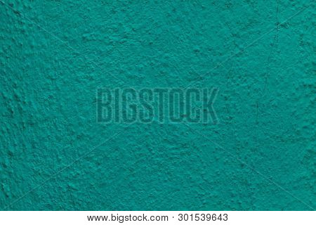 Emerald green painted stucco wall on Burano Island in the Venetian Lagoon near Venice, Italy. Background texture.