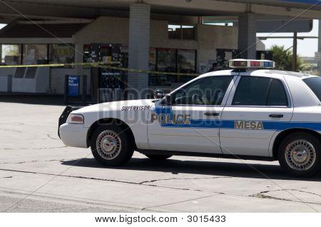 Police Car Parked At Crime Scene