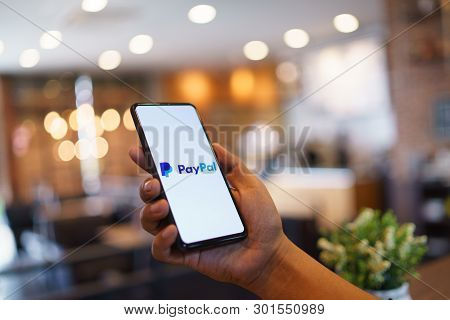 Chiang Mai, Thailand - Mar. 24,2019: Man Holding Xiaomi Mi Mix 3 With Paypal Apps On The Screen. Pay