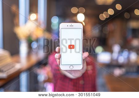 Chiang Mai, Thailand - Apr.08,2019: Woman Holding Apple Iphone 6s Rose Gold With Youtube Apps On Scr