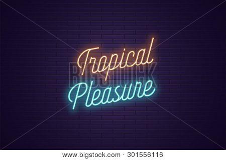Neon Lettering Of Tropical Pleasure. Glowing Headline, Bright Neon Cursive Text Of Tropical Pleasure