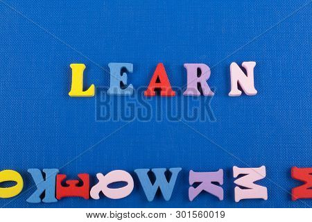 Learn Word On Blue Background Composed From Colorful Abc Alphabet Block Wooden Letters, Copy Space F
