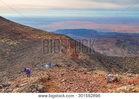 Kamchatka Peninsula, Russia- 28 September 2014: Group Of Hikers Walking On A Mountain, Volcanic Area