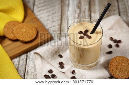 Cold Coffee Yogurt Milkshake Smoothie Drink In A Glass Topped With Coffee Beans And Whole Grain Bisc