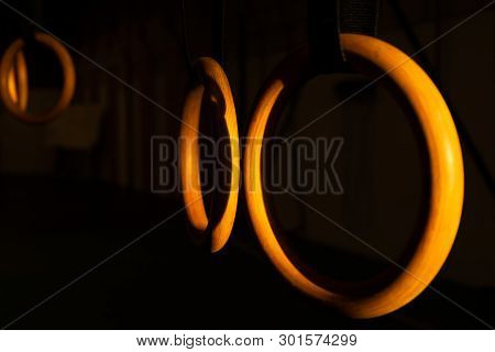 Wooden Gymnastics Or Cross Training Rings Hanging In Gym