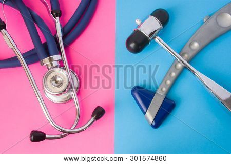 Two Neurological Rubber Reflex Hummers And Medical Stethoscope Is In Two Colors Background: Blue And