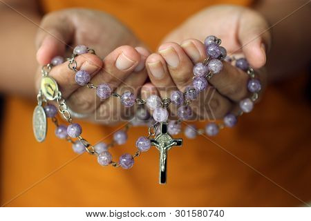 Rosary In Hand. Young Junior Lady Holding Rosary With Open Hand. Female Hands Holding A Rosary With
