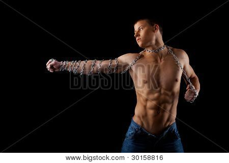 naked man with chain on hands fight on light