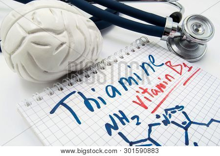 Vitamin B1 Thiamin Concept Photo. Stethoscope And Brain Figure Lies Next To Inscription Vitamin B1 T