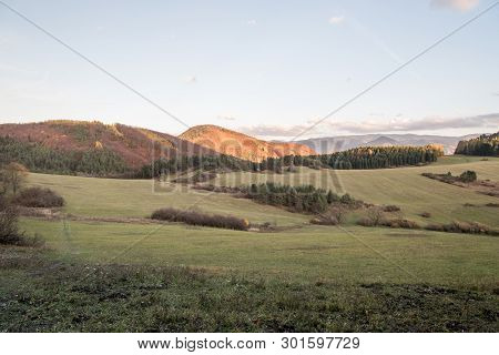 Autumn Evening Scenery With Meadows, Hills Od Sulovske Vrchy And Mala Fatra On Tha Background Covere