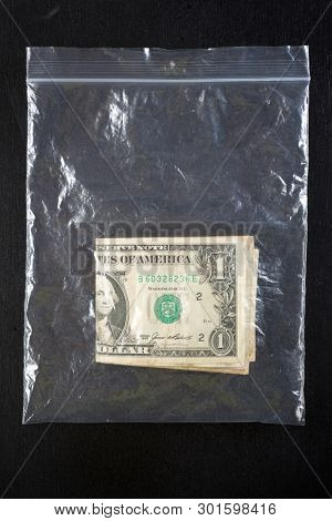 Dollar bills in a plastic bag.