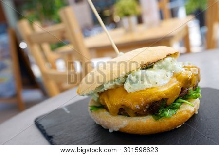 Burger with cheese and lettuce.