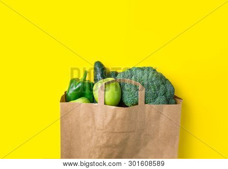 Green Raw Organic Vegetables Fruits Broccoli Cucumbers Bell Peppers Apples In Brown Paper Kraft Groc