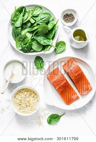 Ingredients For A Balanced Lunch - Salmon Fish, Spinach, Cream, Orzo Pasta On A Light Background, To