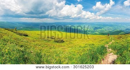 Panoramic Mountain Landscape In Summer.  Green Grassy Hills And Slopes. Path Downhill Through The Me