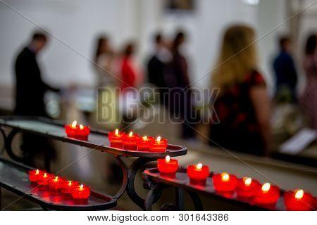 Wedding Marriage Ceremony In Church. Burning Candles In The Church During The Wedding Ceremony. Chri