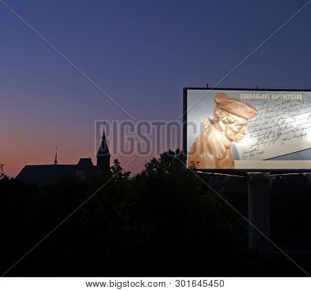 Kaliningrad, Russia - September 26, 2006: An Advertizing Banner With Immanuel Kant S Image Against T