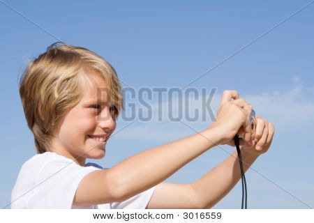 Happy Smiling Child With Camera