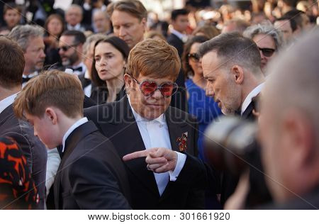 Elton John and husband David Furnish attend the screening of