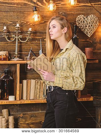 Poetry Evening Concept. Girl Reading Poetry In Warm Atmosphere. Girl In Casual Outfit In Wooden Vint