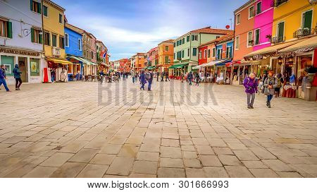 Venice, Italy - November 11th: Tourists Visiting Shops In The Picturesque Fishing Village Of Burano