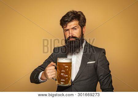 Man In Black Suit Drinking Beer. Man With Beer. Man With Beard Drink Beer. Retro Man With A Beer. En