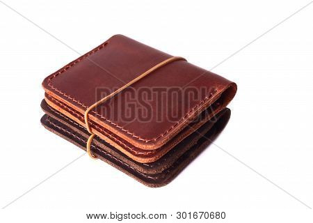 Handmade Two Red And Brown Leather Cardholders With Rubber Band Isolated On White Background Closeup
