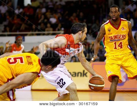 KUALA LUMPUR - FEBRUARY 19: Malaysian Dragons' Ernani Pacana (22) dribbles in at the ASEAN Basketball League match against Singapore Slingers on Feb 19, 2012 in Kuala Lumpur, Malaysia. Dragons won 86-71.