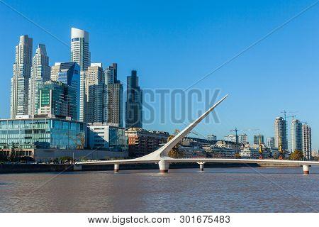 Buenos Aires City Skyline. View Of Puente De La Mujer Womens Bridge , Puerto Madero