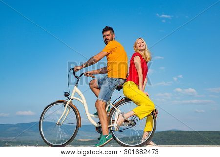 Beautiful Summer Day. Summer Couple. Sexy Couple In Love. Couple In Love Riding A Bike. Active Peopl