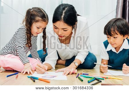 Family Happy Child Kid Girl Kindergarten Paint Drawing On Peper Teacher Education With Mother Mom At