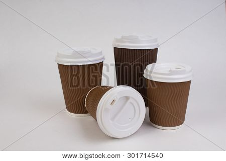 Many Disposable Paper Cups Of Coffee, Tea On White Background With Clipping Path.