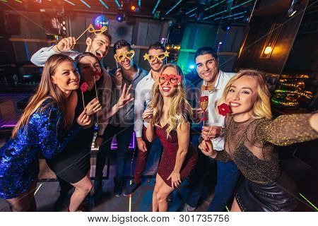Group Of Friends Partying In A Nightclub Make Selfie Photo
