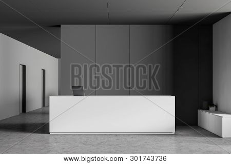 White Reception In Gray Office Lobby