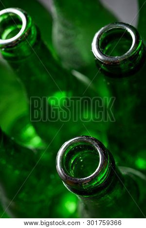 Group of green glass bottles