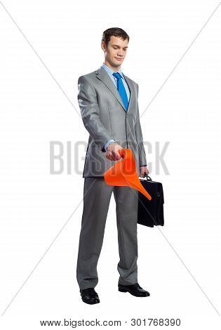 Businessman Wears Grey Suit And Blue Tie With Black Leather Suitcase Holding Orange Plastic Watering