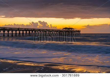 Sunrise Along The Pier In Myrtle Beach, South Carolina