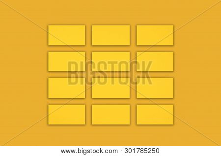 Mockup Of Horizontal Gold Business Cards Stacks Arranged In Rows At Gold Background.