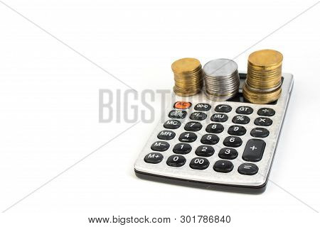 Money, Financial, Business Growth Concept, Stack Of Coins And Calculator On White Background