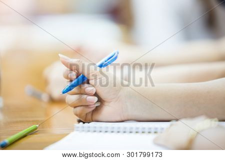 Business Woman Is Writing Lecture In The Meeting Room