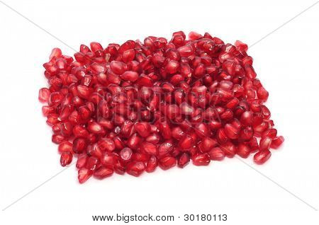 a pile of pomegranate arils on a white background