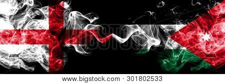 English Vs Jordan, Jordanian Smoky Mystic Flags Placed Side By Side. Thick Colored Silky Smokes Flag