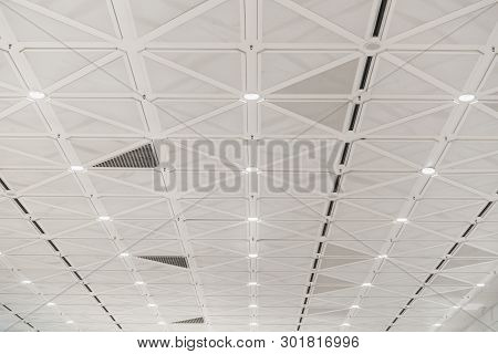 White Ceiling With Neon Lights In The Office. White Ceiling Can Reflect Light Well. The Right Light