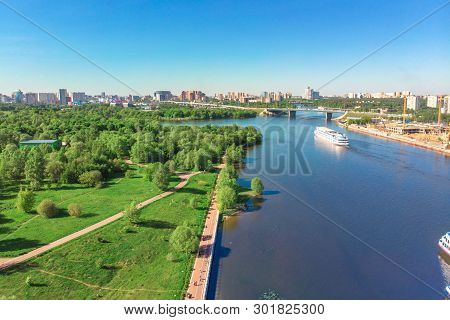 Scenic View Of The City By The River With Ships Sailing On It. Concept Clean City, Life In The City.