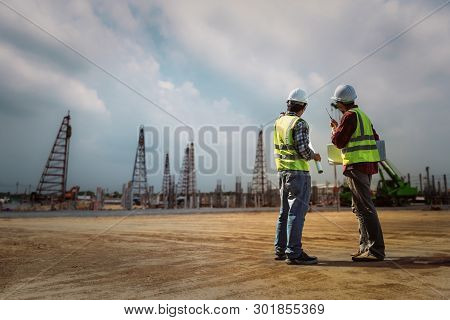 Construction Engineers Discussion With Architects At Construction Site Or Building Site. Consultant