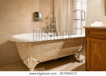 Bathtub With Vintage Bathtub Fixtures With Flexible Shower Head.