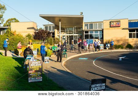 Melbourne, Australia - May 18, 2019: Political Party Supporters Handing Out How To Vote Cards Outsid